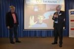 Metin Tolan (links) bei seinem Vortrag
